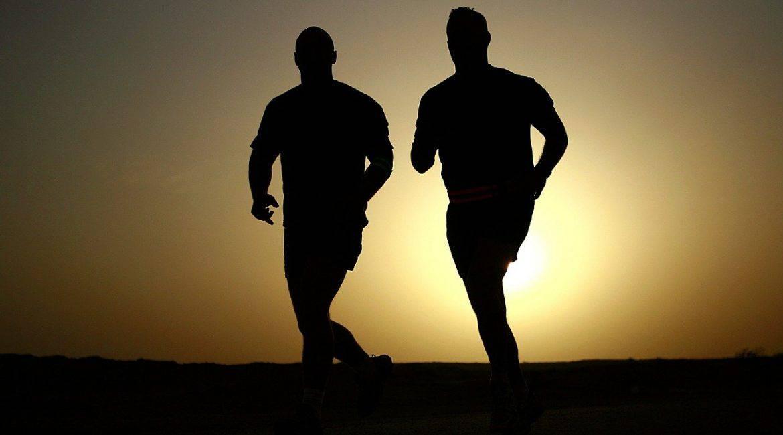 two men running as sun sets